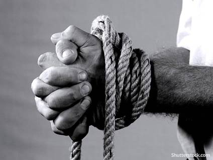 man ropes tied wrists captive victim