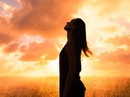 Stress-free woman at sunset