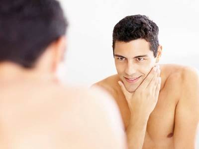 Man Looking At Self in Mirror