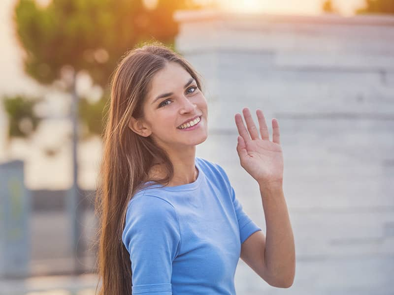 woman waving