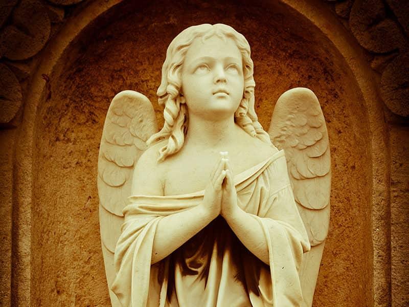 Angel statue praying