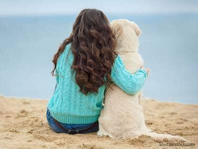 teen girl beach dog
