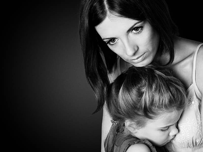guilty mother with daughter black and white dark