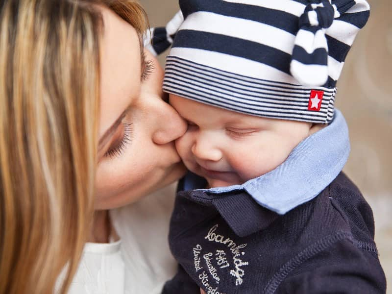 baby kissed by mom