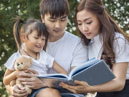 Family reading with child