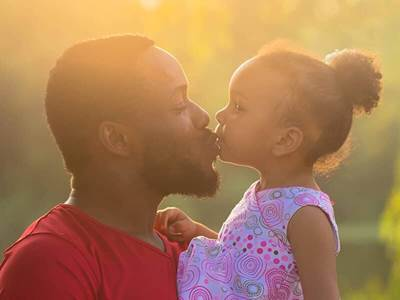 Father daughter kiss