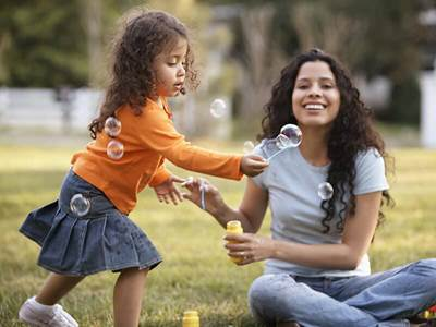mother daughter play bubbles