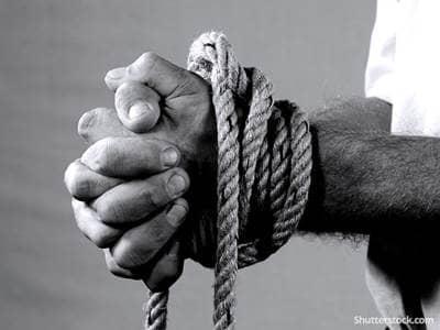 man ropes tied wrists captive victim