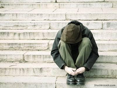 man sad homeless stairs
