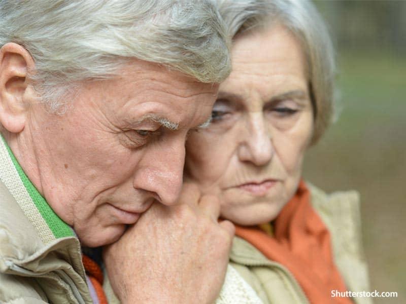 people sad elder couple