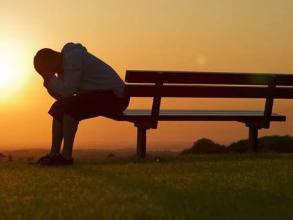 Grieving Man On Bench