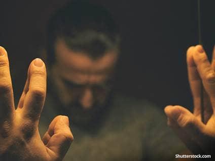 depression-man-reflection-hands