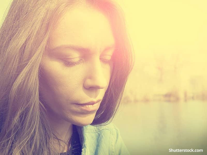 depression-woman-sun-closedeyes-pray