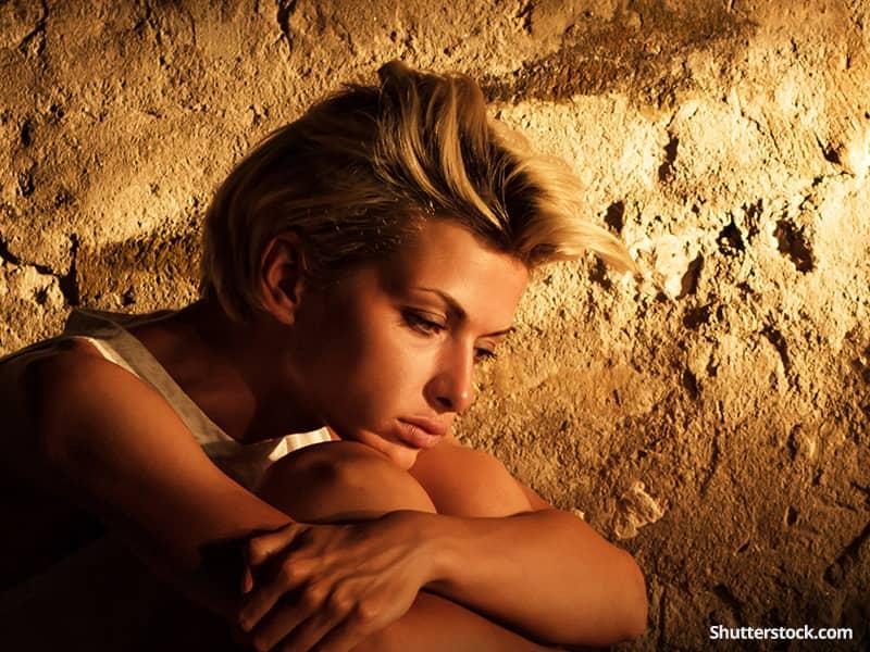 depression-woman-wall-sun