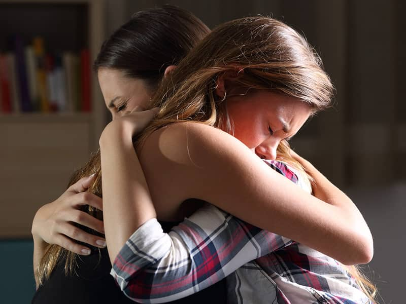 friends crying hugging