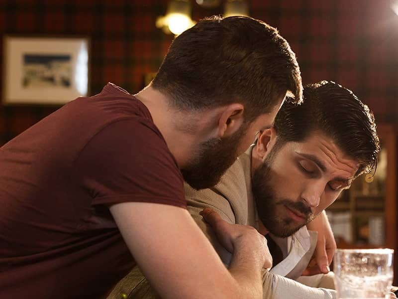 men comforting friends