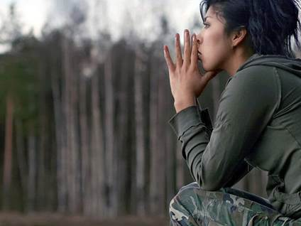 Female Military Member Thinking