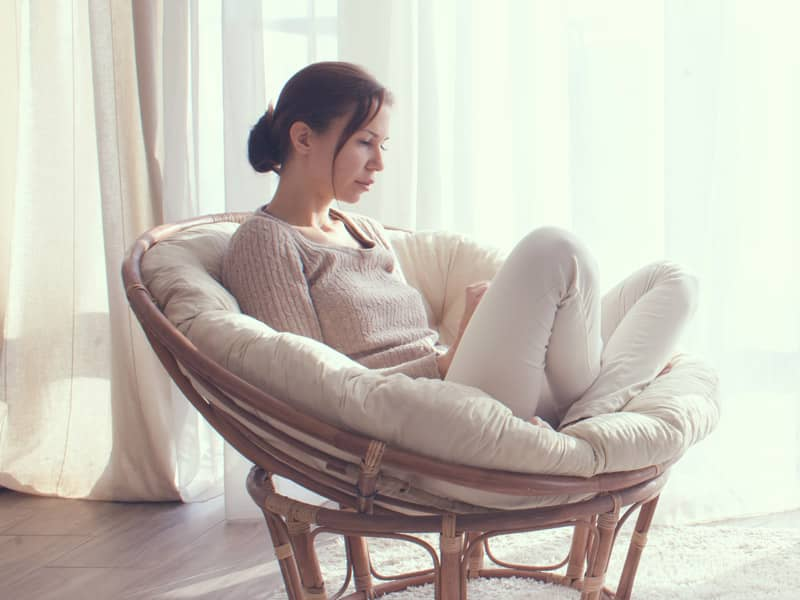 woman sitting on chair depressed
