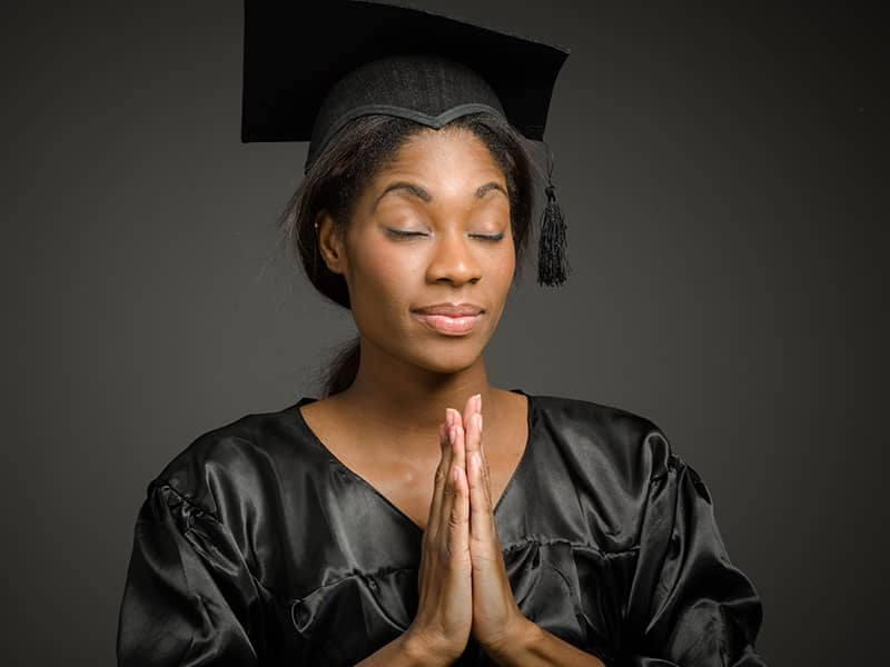 Praying college grad