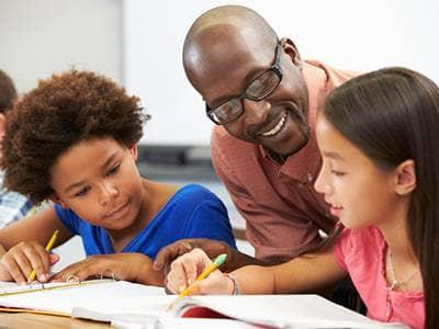 Teacher Helping Students