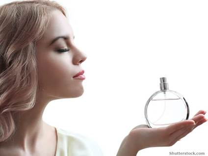 woman holding perfume