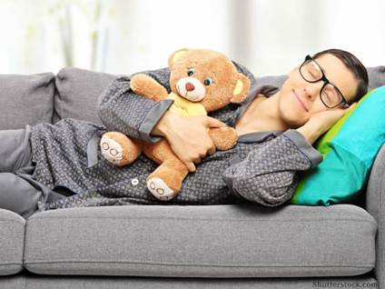 Young adult holding teddy bear