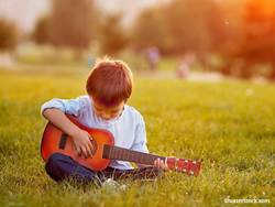 people-child-play-guitar-outside