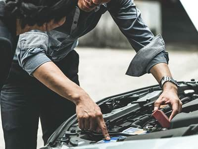 man working on car mechanic