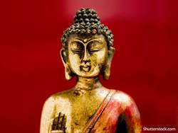 buddah-gold-statue-on-red