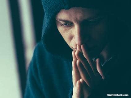 man sad praying