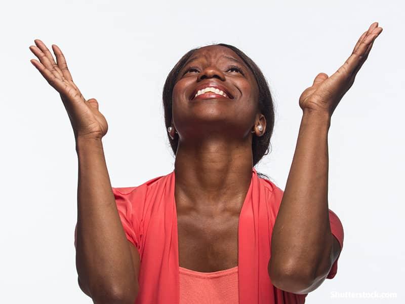 young woman praising