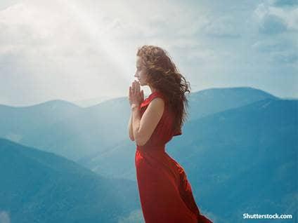 woman praying mountain