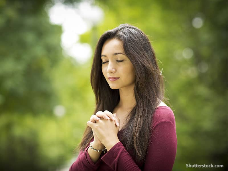 woman praying outdoors