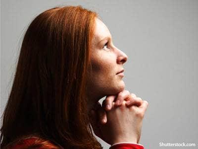 woman praying thinking