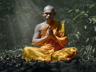 praying Buddhist monk