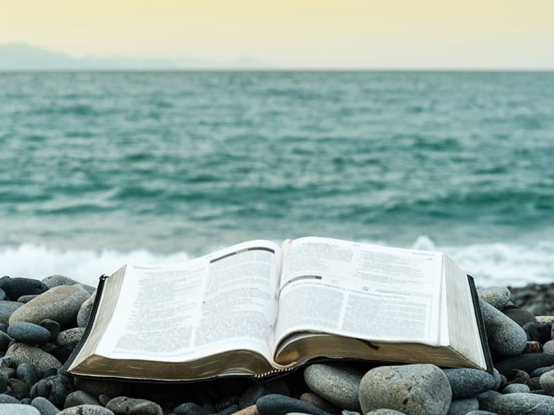 bible at ocean on rocks