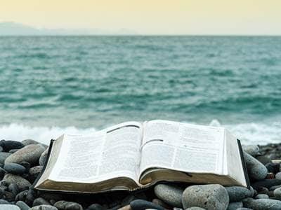 bible at ocean on rocks