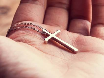 cross in palm of hand