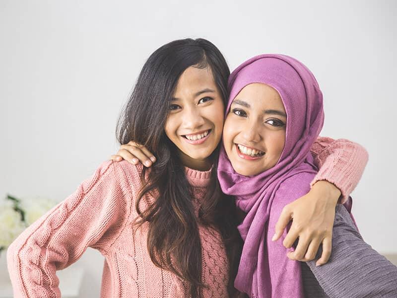 interfaith friends muslim christian girls