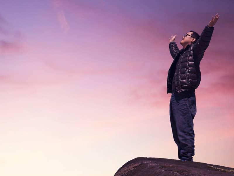 man praise on mountain