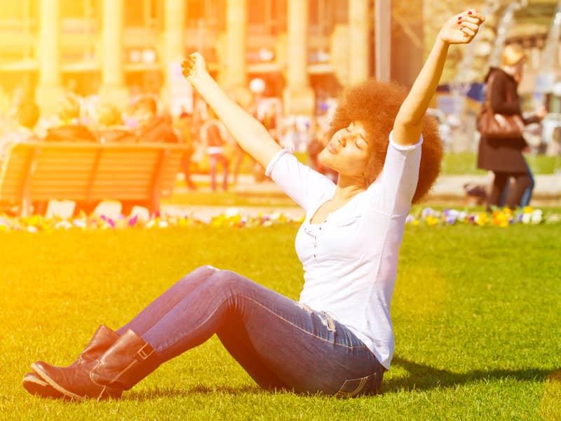 woman praise at park