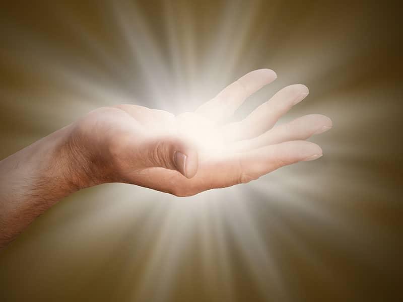 hand glowing