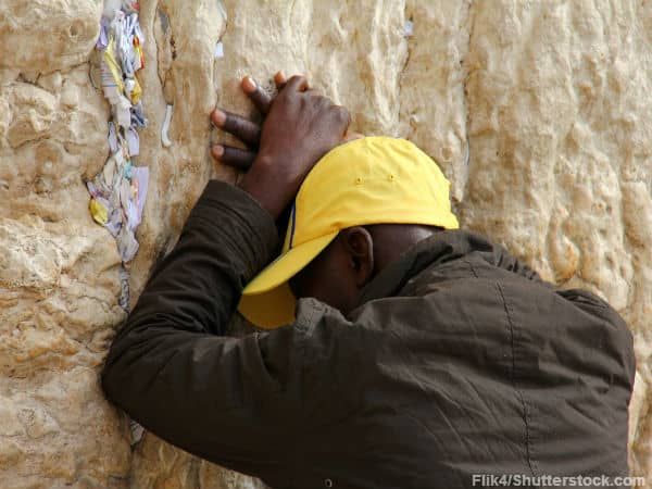 Man praying at Wailing Wall