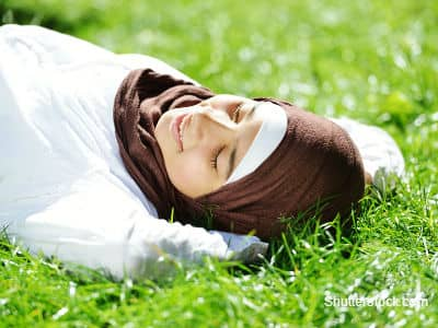 Muslim Girl Laying in Grass