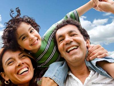 latino-family-parents-child-sky