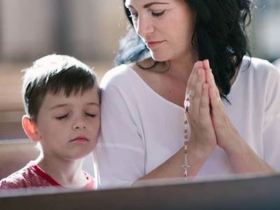 Mom and son in church
