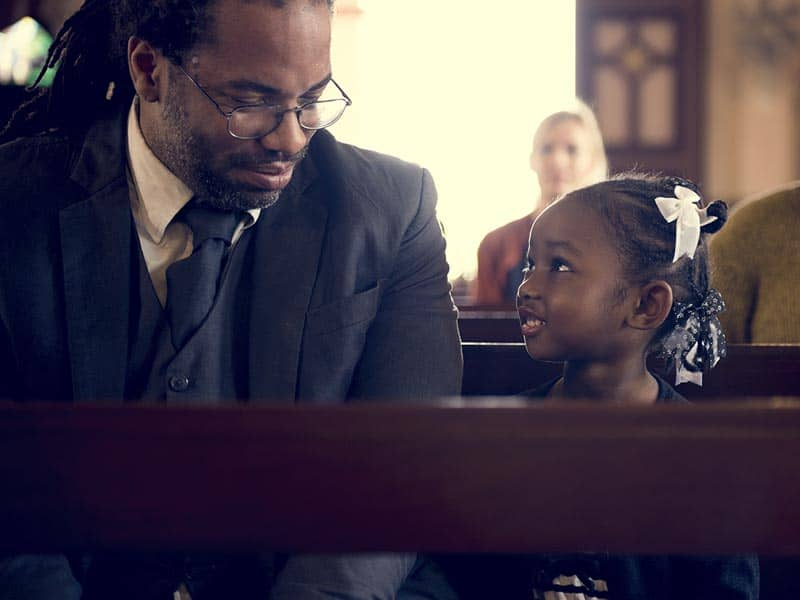 father and daughter at church