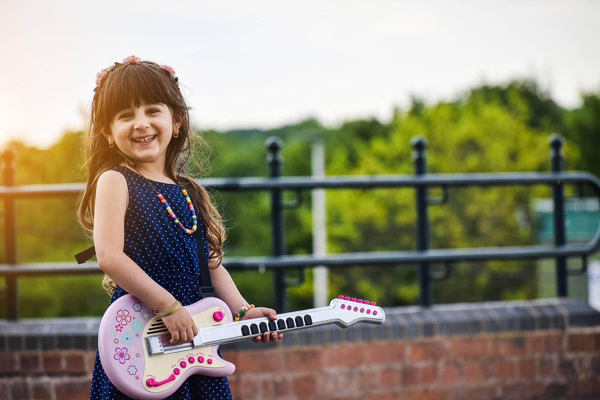 child playing pretend guitar