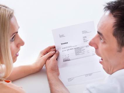 Shocked Couple With Invoice