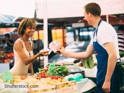 Woman Paying at Farmers' Market
